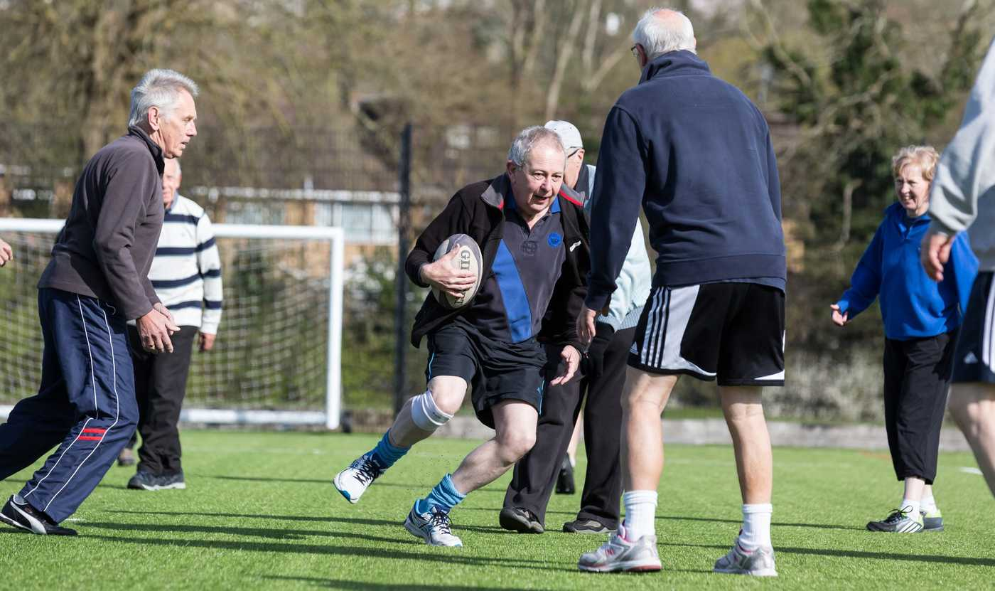 Elderly men playing walking rugby