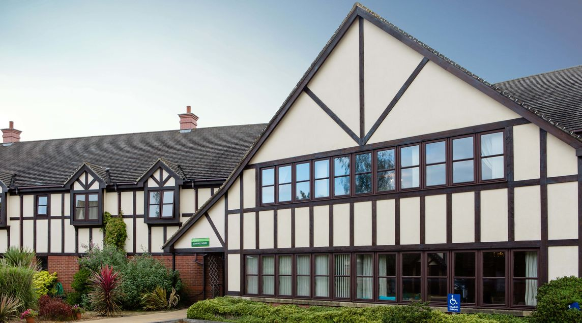 A picture of John Wills House care home where St Monica Trust offer end of life care in Bristol
