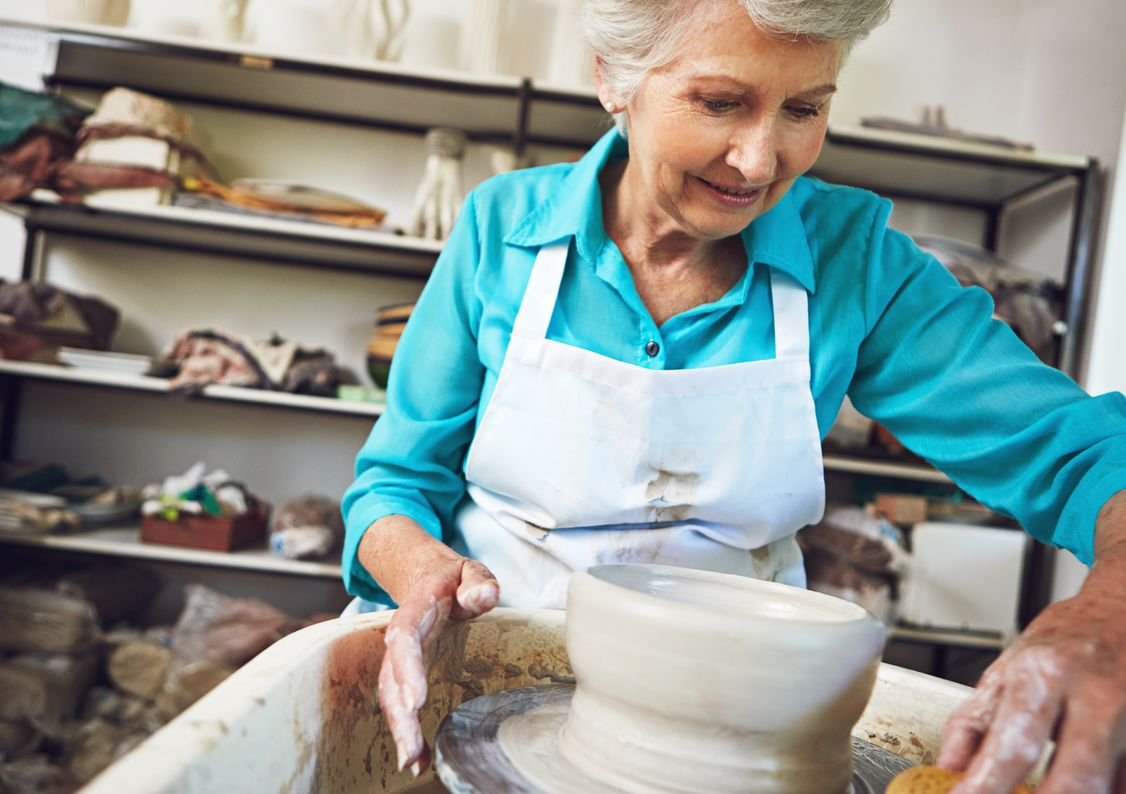 An elderly lady doing pottery