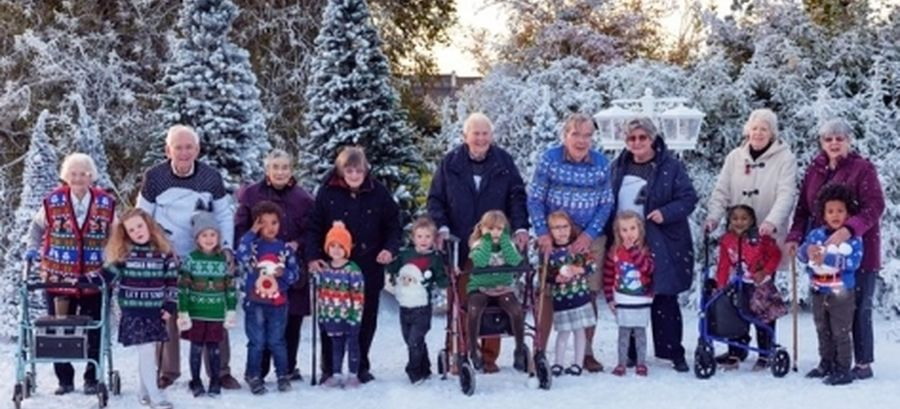 Elderly people and children in the snow at Cote Lane