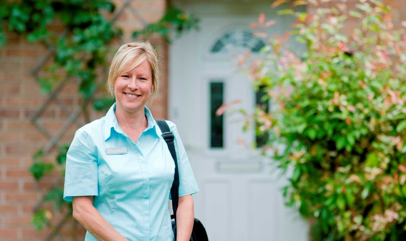 A Care at Home team member standing outside a house, ready to deliver home care in Bristol