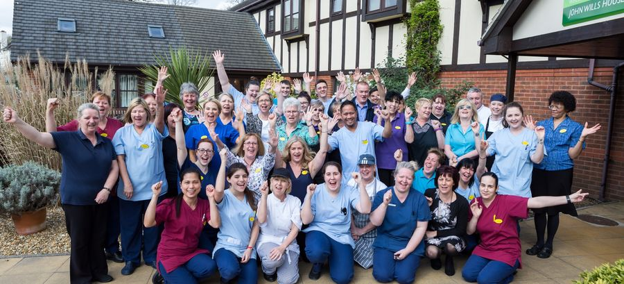John Wills House staff group picture celebrating their CQC result