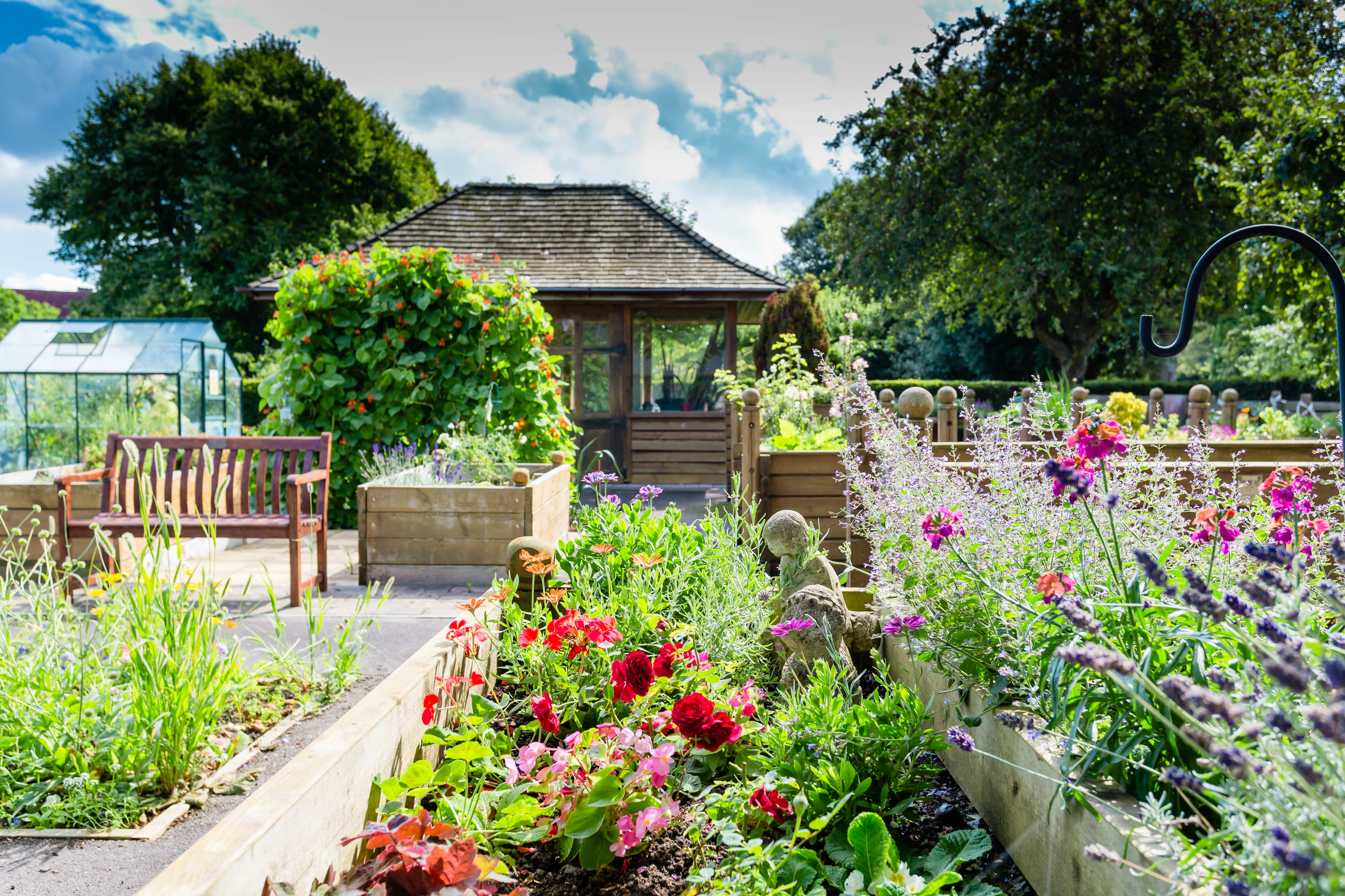 Garden and allotments within a retirement community in Westbury-on-Trym, Bristol. Communal areas are a large thing to consider when asking 'what is a retirement village?'