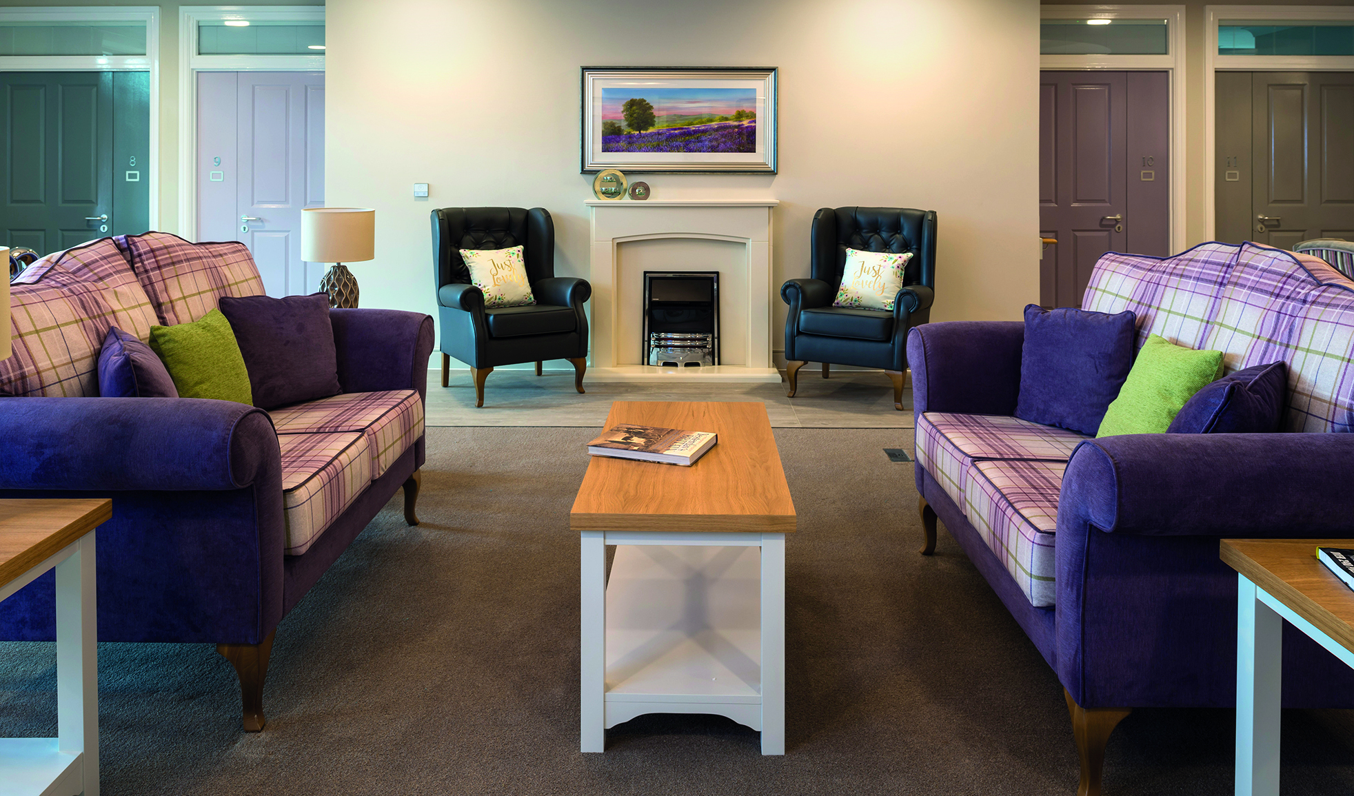Chairs and table in a lounge area in the Charterhouse Care Home