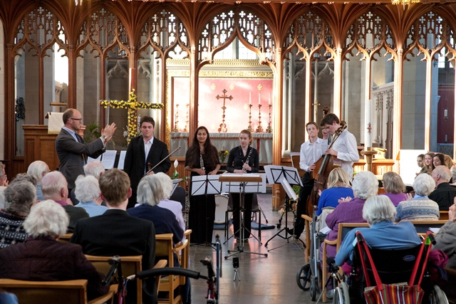 Resints applaud the young musicians performing in the chapel